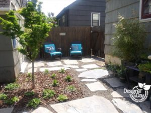 Concordia hardscape landscaping with multiple outdoor rooms.