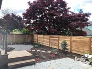 Landscape design creates clients dream garden in Laurelhurst neighborhood with new fence, path and patio hardscape.