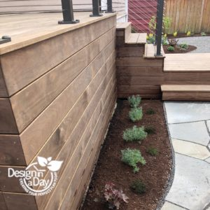 Close up of Kebony deck skirt and herb bed in Portland, Oregon landscape design