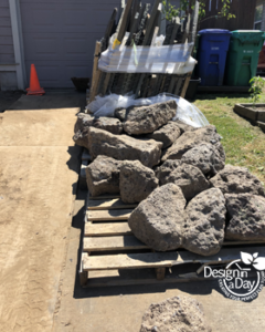 Woodlawn home gets Mossy rock delivery for new landscape