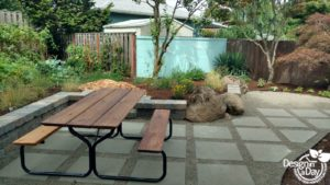modern landscape design is enhanced with large rustic boulder and pollinator garden plants in Portland, Oregon