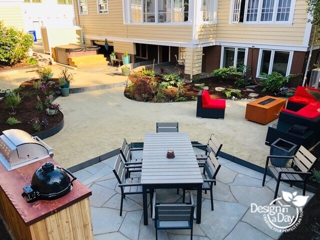 Outdoor kitchen, dining, hot tub and a lounging area fit into this Mt Tabor backyard