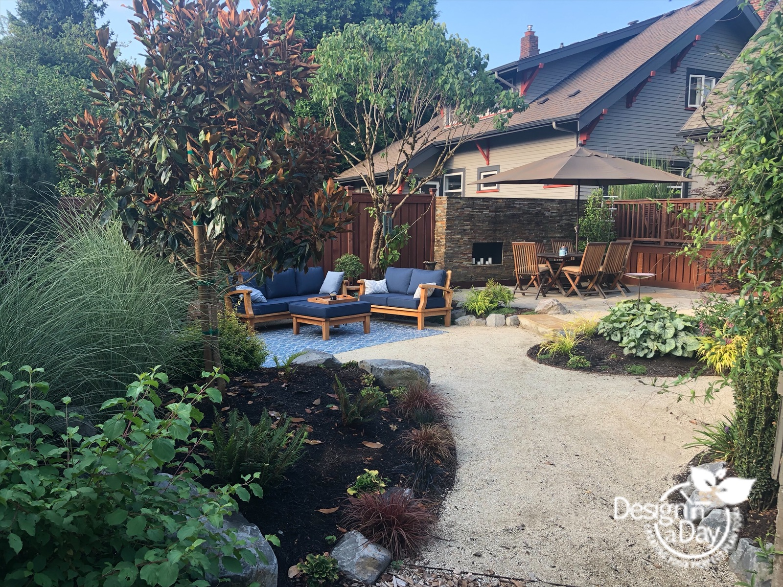 Private outdoor entertaining with multiple sitting areas is spacious for Grant Park lansdscape.