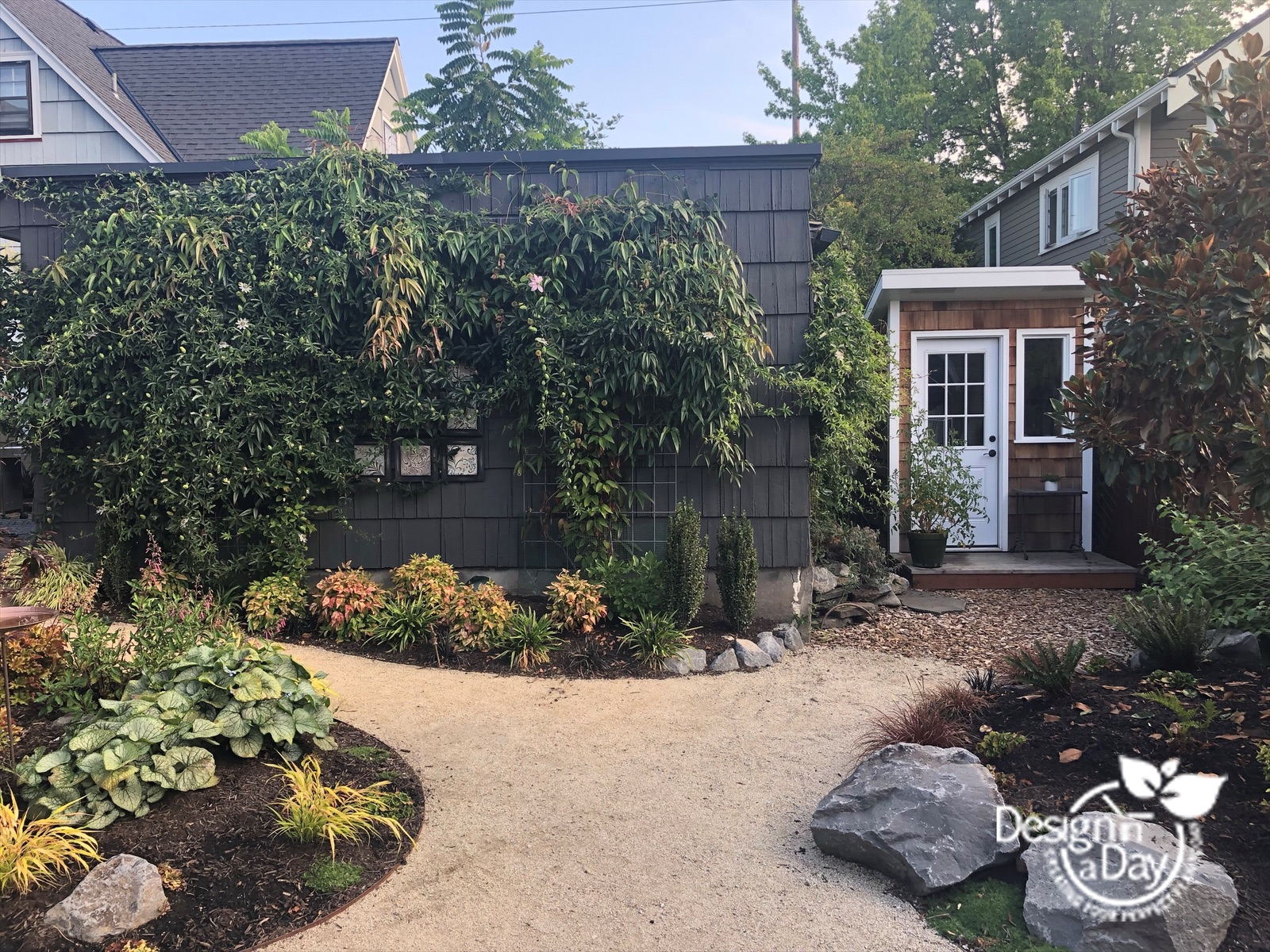 Outdoor living landscaping with granite path and custom shed in Grant Park neighborhood.