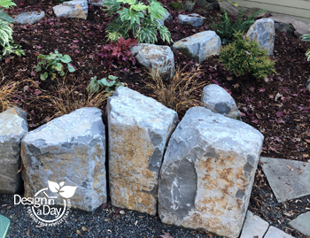 Boulders create interest for gas fire pit patio