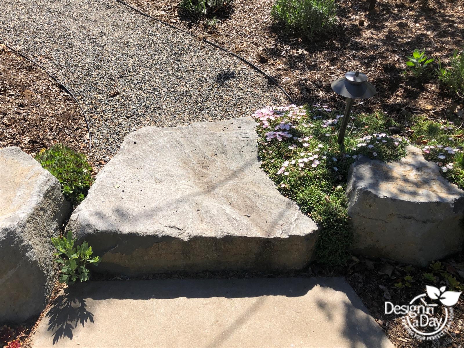 drought tolerant landscape design includes boulders