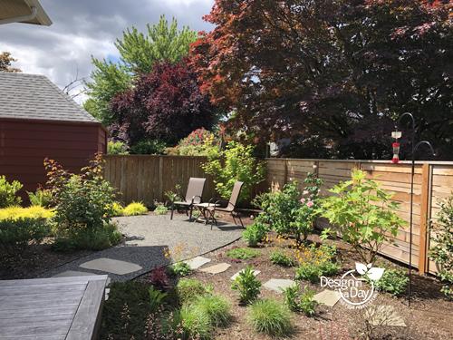 Laurelhurst home landscape design creates sitting area and room for gardeners plantsplants.