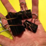 Portland area landscape designer uses binder clips to secure covers over heat stressed plants