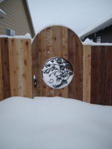 Custom iron gate in snow