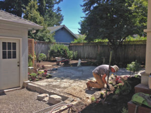 Installing the patio Grant Park N. E. Portland Landscape Design in a Day in this dog friendly garden.