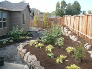 Landscape design solves drainage problems in Salmon Creek back yard.