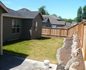 This Salmon Creek back yard in Vancouver had drainage problems before their landscape design.