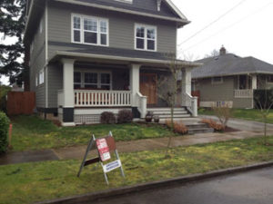 Before photo shows beautiful Portland home with unattractive front landscape