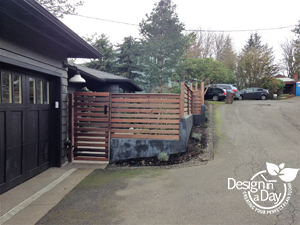 Modern style fencing creates courtyard style landscape design for West Hills home in Portland Oregon . Dyed concrete walls and wood fence