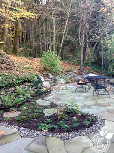 Hardscape Landscape Design for Portland hilllside home includes stone patio and boulders