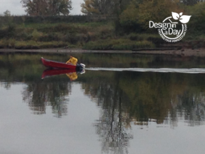Portland landscape designers' view of fall fisherman in red boat