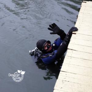 Floating home Multnomah Channel diver checks floatation