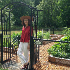 Carol standing at the entrance to community garden at Rocky Pointe Marina 7 23 2014
