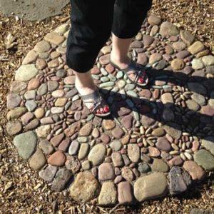 My sister's feet on a Jeffrey Bale stone mosiac landing.